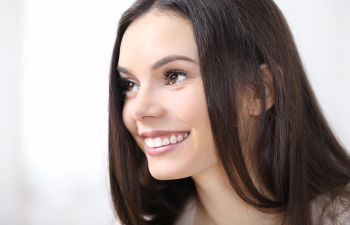 Profile of a young smiling woman.